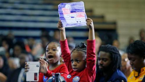 Kaylen Johnson, left, and London Walters, both 6, hold a drawing and take pictures before Democratic presidential candidate Hillary Clinton walks onstage to speak at a campaign event at Morris College in Sumter, S.C., Wednesday, Feb. 24, 2016. (AP Photo/Gerald Herbert)