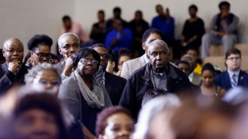 Audience members listen as Democratic presidential candidate Hillary Clinton speaks at a campaign event at Morris College in Sumter, S.C., Wednesday, Feb. 24, 2016. (AP Photo/Gerald Herbert)