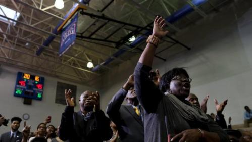 Roberta Harrison (R) of New Zion, South Carolina, cheers for U.S. Democratic presidential candidate Hillary Clinton as she speaks to voters at the Garrick-Boykin Human Development Center at Morris College in Sumter, South Carolina, February 24, 2016. REUTERS/Randall Hill