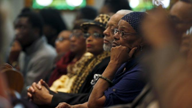 People listen as U.S. Senator Cory Booker (D-NJ) introduces U.S. Democratic presidential candidate Hillary Clinton at a town hall meeting for supporters at Cumberland United Methodist Church in Florence, South Carolina February 25, 2016. REUTERS/Jonathan Ernst