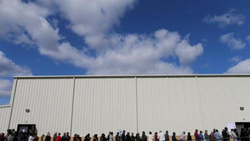 People line up for a town hall rally for U.S. Democratic presidential candidate Hillary Clinton at the Williamsburg County Recreation Center in Kingstree, South Carolina, February 25, 2016. REUTERS/Randall Hill