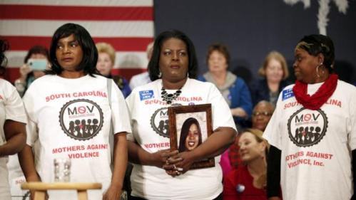 Barbara Hytower (C), holding a photo of her daughter Jamila, stands with other members of the South Carolina Mothers Against Violence before the start of a rally for U.S. Democratic presidential candidate Hillary Clinton at the Myrtle Beach Convention Center in Myrtle Beach, South Carolina, February 25, 2016. Jamila Hytower was murdered in 2006 in Myrtle Beach. REUTERS/Randall Hill
