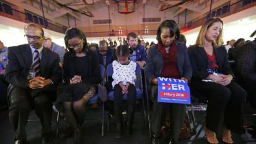 Audience members bow their heads in prayer during the invocation before Democratic presidential candidate Hillary Clinton arrives tospeak at a campaign event at the Royal Baptist Church Family Life Center in North Charleston, S.C., Thursday, Feb. 25, 2016. (AP Photo/Gerald Herbert)