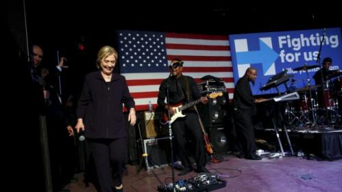 Democratic U.S. presidential candidate Hillary Clinton joins singer Charlie Wilson (not pictured) and his band onstage during a get-out-the-vote concert in support of her at the Music Farm in Charleston, South Carolina February 25, 2016. REUTERS/Jonathan Ernst