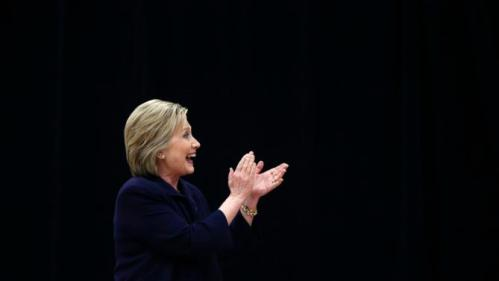 Democratic presidential candidate Hillary Clinton acknowledges the audience as she arrives to speak at a town hall style campaign event at the Williamsburg County Recreation Center in Kingstree, S.C., Thursday, Feb. 25, 2016. (AP Photo/Gerald Herbert)