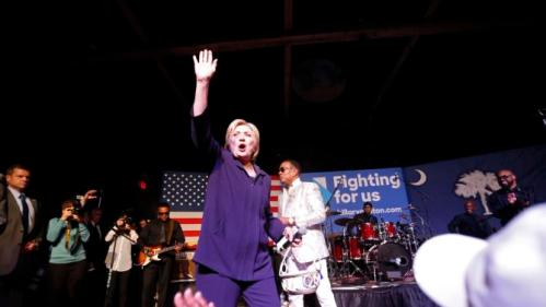 """Democratic presidential candidate Hillary Clinton appears onstage with recording artist Charlie Wilson during a """"Get Out The Vote"""" concert at The Music Farm in Charleston, S.C., Thursday, Feb. 25, 2016. (AP Photo/Gerald Herbert)"""