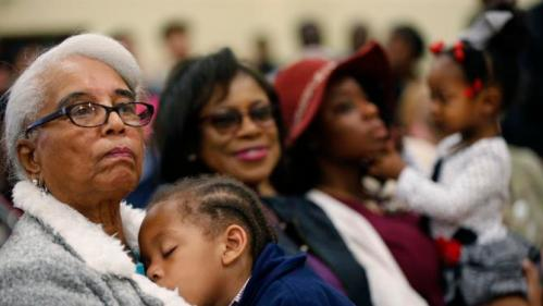 Audience members listen as Democratic presidential candidate Hillary Clinton speaks at a campaign event at the Williamsburg County Recreation Center in Kingstree, S.C., Thursday, Feb. 25, 2016. (AP Photo/Gerald Herbert)