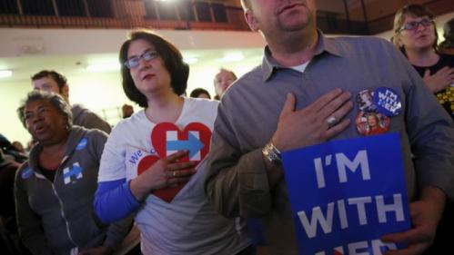 People stand for the national anthem before U.S. Democratic presidential candidate Hillary Clinton holds a town hall meeting for supporters at Royal Baptist Church Family Life Center in North Charleston, South Carolina February 25, 2016. REUTERS/Jonathan Ernst