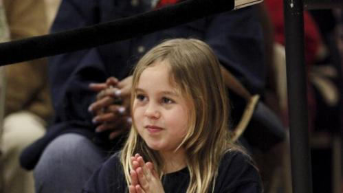 Phoebe Jordan, 9, of Charleston, South Carolina, claps for U.S. Democratic presidential candidate Hillary Clinton during her speech to voters at the Williamsburg County Recreation Center in Kingstree, South Carolina, February 25, 2016. REUTERS/Randall Hill