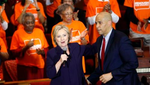 Sen. Corey Booker, D-N.J., introduces Democratic presidential candidate Hillary Clinton at a campaign event at the Cumberland United Methodist Church in Florence, S.C., Thursday, Feb. 25, 2016. (AP Photo/Gerald Herbert)