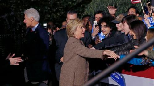 "Democratic presidential candidate Hillary Clinton and her husband, former President Bill Clinton, greet supporters as they arrive to speak at a ""Get Out The Vote Rally"" in Columbia, S.C., Friday, Feb. 26, 2016. (AP Photo/Gerald Herbert)"