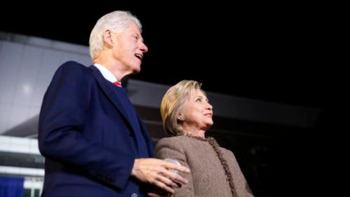 "Democratic presidential candidate Hillary Clinton and her husband, former President Bill Clinton, arrive onstage to speak at a ""Get Out The Vote Rally"" in Columbia, S.C., Friday, Feb. 26, 2016. (AP Photo/Gerald Herbert)"