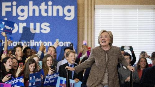 Democratic presidential candidate Hillary Clinton steps on stage for a campaign event at the Old City Council Chambers in City Hall, Friday, Feb. 26, 2016, in Atlanta. (AP Photo/David Goldman)