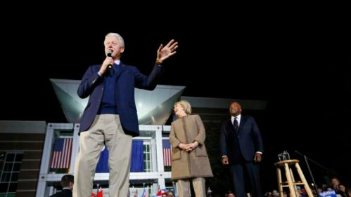"""Democratic presidential candidate Hillary Clinton and her husband, former President Bill Clinton, speak at a """"Get Out The Vote Rally"""" in Columbia, S.C., Friday, Feb. 26, 2016. Right is Columbia Mayor Stephen K. Benjamin. (AP Photo/Gerald Herbert)"""