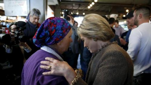 U.S. Democratic Presidential candidate Hillary Clinton listens to a worker at Saffron Cafe and Bakery as she arrives to greet voters at the cafe in Charleston, South Carolina, February 26, 2016. REUTERS/Jonathan Ernst