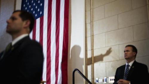 Democratic presidential candidate Hillary Clinton casts a shadow while speaking at a campaign event under the security of the secret service at the Old City Council Chambers in City Hall, Friday, Feb. 26, 2016, in Atlanta. (AP Photo/David Goldman)