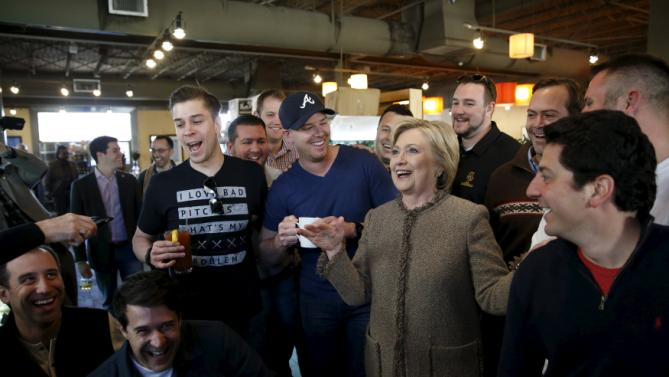 U.S. Democratic presidential candidate Hillary Clinton politely declines a Bloody Mary from a group of men starting a day of bachelor party festivities as she greets people at Saffron Cafe and Bakery in Charleston, South Carolina February 26, 2016. REUTERS/Jonathan Ernst      TPX IMAGES OF THE DAY