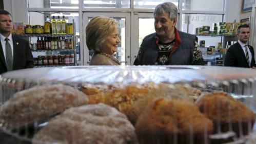 U.S. Democratic presidential candidate Hillary Clinton speaks with Saffron Cafe and Bakery owner Ali Rahnamoon as she arrives to greet people at his cafe in Charleston, South Carolina February 26, 2016. REUTERS/Jonathan Ernst