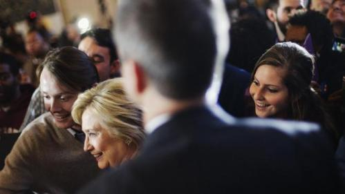 An audience member at right photo bombs a selfie with Democratic presidential candidate Hillary Clinton as she greets the crowd at a campaign event at the Old City Council Chambers in City Hall, Friday, Feb. 26, 2016, in Atlanta. (AP Photo/David Goldman)