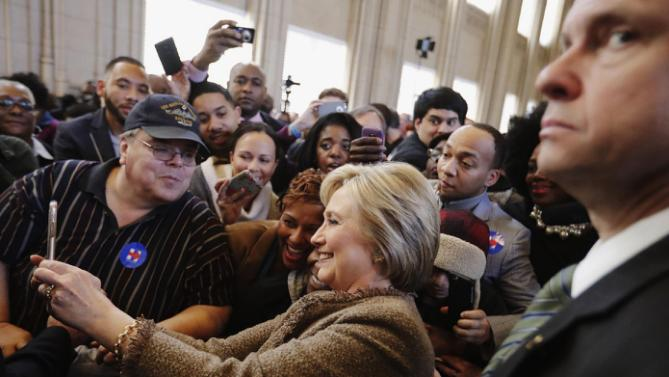 Democratic presidential candidate Hillary Clinton takes a selfie with an audience member's phone as she greets the crowd at a campaign event at the Old City Council Chambers in City Hall, Friday, Feb. 26, 2016, in Atlanta. (AP Photo/David Goldman)