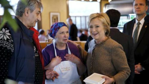 U.S. Democratic presidential candidate Hillary Clinton greets Saffron Cafe and Bakery diners and workers, including owner Ali Rahnamoon, in Charleston, South Carolina February 26, 2016. REUTERS/Jonathan Ernst