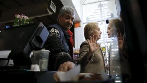 U.S. Democratic presidential candidate Hillary Clinton politely declines to eat more cake samples, after having tried the coconut pound cake and purchasing items to go from Saffron Cafe and Bakery owner Ali Rahnamoon as she greets people at his cafe in Charleston, South Carolina February 26, 2016. REUTERS/Jonathan Ernst TPX IMAGES OF THE DAY