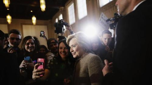 Democratic presidential candidate, Hillary Clinton poses for a selfie with an audience member as she greets the crowd at a campaign event at the Old City Council Chambers in City Hall, Friday, Feb. 26, 2016, in Atlanta. (AP Photo/David Goldman)