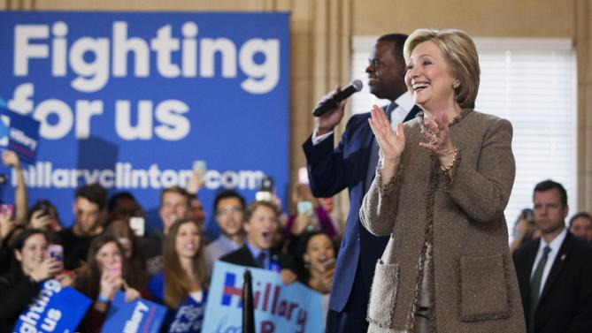 Democratic presidential candidate Hillary Clinton steps on stage with Atlanta Mayor Kasim Reed at a campaign event at the Old City Council Chambers in City Hall, Friday, Feb. 26, 2016, in Atlanta. (AP Photo/David Goldman)