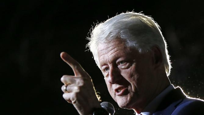 "Former President Bill Clinton speaks on behalf of his wife, Democratic presidential candidate Hillary Clinton at a ""Get Out The Vote Rally"" in Columbia, S.C., Friday, Feb. 26, 2016. (AP Photo/Gerald Herbert)"