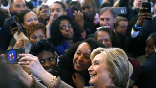 RE-FILING CLARIFYING LOCATION OF PHOTO Democratic U.S. presidential candidate Hillary Clinton takes selfies with people during a campaign stop at Atlanta City Hall in Atlanta, Georgia February 26, 2016. REUTERS/Christopher Aluka Berry