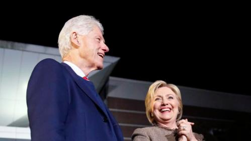 "Democratic presidential candidate Hillary Clinton and her husband, former President Bill Clinton, arrive to speak at a ""Get Out The Vote Rally"" in Columbia, S.C., Friday, Feb. 26, 2016. (AP Photo/Gerald Herbert)"