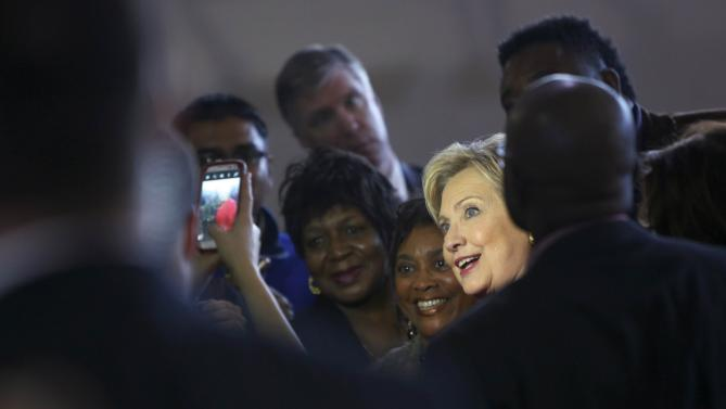 Democratic U.S. presidential candidate Hillary Clinton greets supporters after a forum at Denmark-Olar Elementary School in Denmark, South Carolina, in this February 12, 2016 file photo. Clinton is poised to win big over the U.S. Senator from Vermont in South Carolina's primary contest on Saturday, in part because of her outsized support among the state's rural black poor - a bloc that Sanders has struggled to impress. REUTERS/Jonathan Ernst