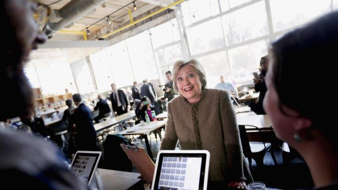 Democratic presidential candidate, Hillary Clinton greets workers while ordering a cappuccino on a visit to Octane Coffee, Friday, Feb. 26, 2016, in Atlanta. (AP Photo/David Goldman)