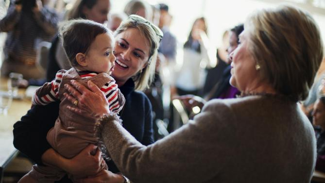 Democratic presidential candidate Hillary Clinton, right, greets Laura Ulep and her son Grady, 15-months, of Atlanta, while visiting Octane Coffee, Friday, Feb. 26, 2016, in Atlanta. (AP Photo/David Goldman)