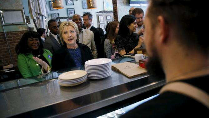 U.S. Democratic presidential candidate Hillary Clinton orders a shot of espresso as she greets people at Urban Standard coffee shop in Birmingham, Alabama February 27, 2016. REUTERS/Jonathan Ernst
