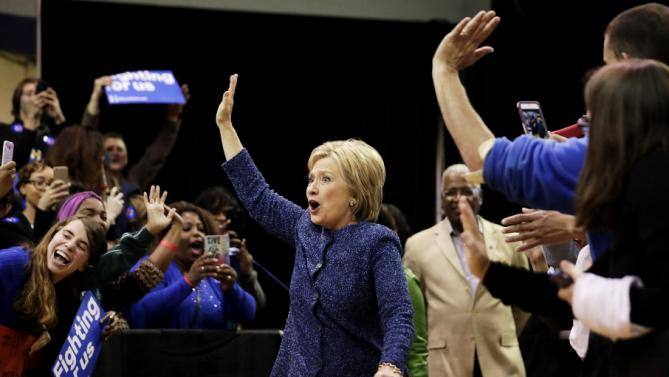 Democratic presidential candidate, Hillary Clinton waves to the crowd as she arrives for a campaign event at Miles College Saturday, Feb. 27, 2016, in Fairfield, Ala. (AP Photo/David Goldman)