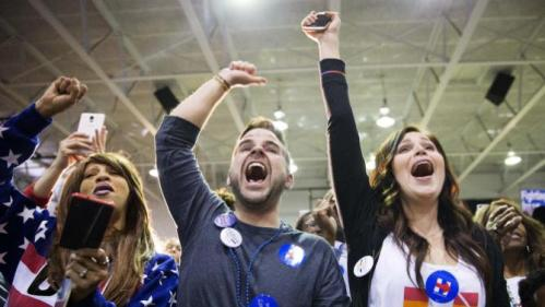 Audience members cheer as Democratic presidential candidate, Hillary Clinton is introduced at a campaign event at Miles College Saturday, Feb. 27, 2016, in Fairfield, Ala. (AP Photo/David Goldman)