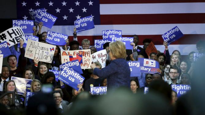 People cheer for U.S. Democratic presidential candidate Hillary Clinton as she rallies with supporters at Miles College in Fairfield, Alabama February 27, 2016. REUTERS/Jonathan Ernst