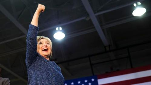 Democratic presidential candidate, Hillary Clinton gestures to the crowd as she takes the stage for a campaign event at Miles College Saturday, Feb. 27, 2016, in Fairfield, Ala. (AP Photo/David Goldman)