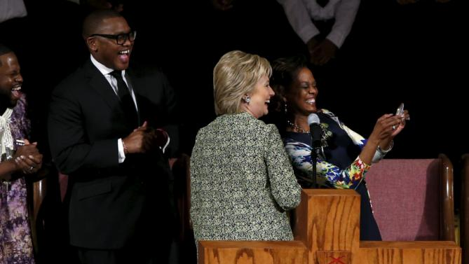 U.S. Democratic presidential candidate Hillary Clinton stops to indulge a selfie after speaking at a worship service at the Mississippi Boulevard Christian Church in Memphis, Tennessee, February 28, 2016. REUTERS/Jonathan Ernst