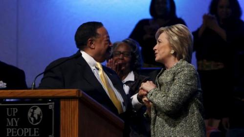 U.S. Democratic presidential candidate Hillary Clinton clasps hands with pastor Bill Adkins (L) after speaking during a church service at the Greater Imani Cathedral of Faith in Memphis, Tennessee, February 28, 2016. REUTERS/Jonathan Ernst