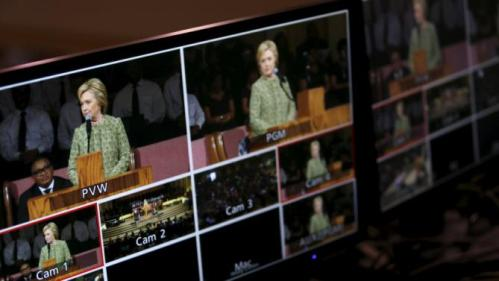 U.S. Democratic presidential candidate Hillary Clinton appears on the television monitors as she speaks during a worship service at the Mississippi Boulevard Christian Church in Memphis, Tennessee, February 28, 2016. REUTERS/Jonathan Ernst