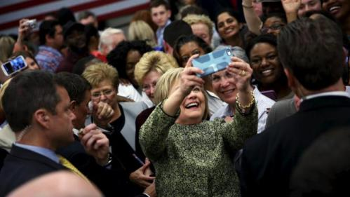 U.S. Democratic presidential candidate Hillary Clinton takes a selfie with supporters at Meharry Medical College in Nashville, Tennessee, February 28, 2016. REUTERS/Jonathan Ernst