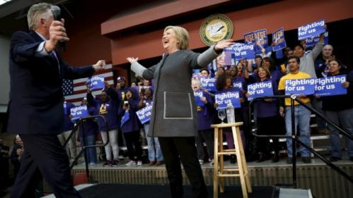 U.S. Democratic presidential candidate Hillary Clinton (C) takes the stage with Virginia Governor Terry McAuliffe to rally with supporters at George Mason University in Fairfax, Virginia February 29, 2016. REUTERS/Jonathan Ernst