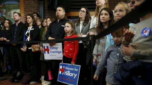 Supporters of U.S. Democratic presidential candidate Hillary Clinton listen to her speak at a rally at Wood Museum of Springfield History in Springfield, Massachusetts February 29, 2016. REUTERS/Jonathan Ernst
