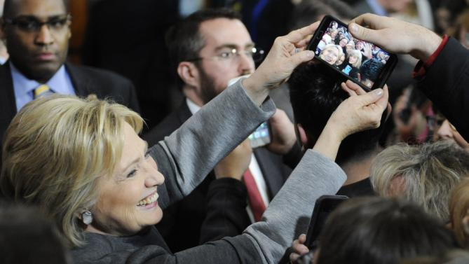 Democratic presidential candidate Hillary Clinton holds a phone for a photo during a campaign event, Monday, Feb. 29, 2016, in Springfield, Mass. (AP Photo/Jessica Hill)