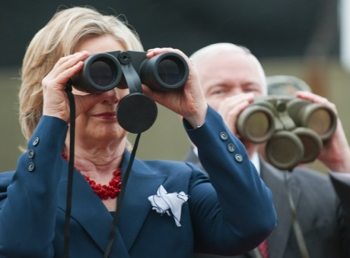 US Secretary of State Hillary Clinton looks towards North Korea as US Secretary of Defense stands by as they visit the dimilitary zone that divides North and South Korea on July 21, 2010. AFP PHOTO/Paul J. Richards (Photo credit should read PAUL J. RICHARDS/AFP/Getty Images)