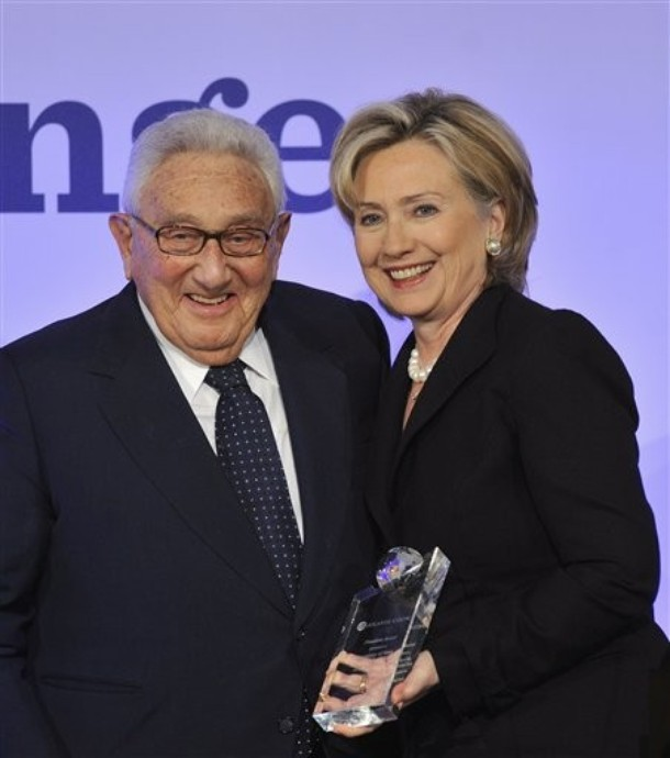 "Henry Kissinger, left, former U.S. Secretary of State, hands over the Freedom Award "" in recognition of their fight for democracy and liberty"" for the American People to U.S. Secretary of State Hillary Clinton, right, during the Freedom Awards Ceremony of the Atlantic Council in Berlin, Sunday, Nov. 8, 2009. (AP Photo/Gero Breloer)"