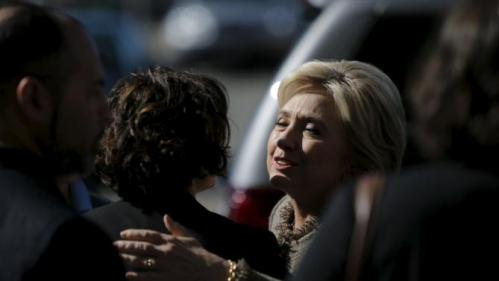 U.S. Democratic presidential candidate Hillary Clinton hugs a supporter after greeting people at Midtown Global Market in Minneapolis, Minnesota March 1, 2016. REUTERS/Jonathan Ernst