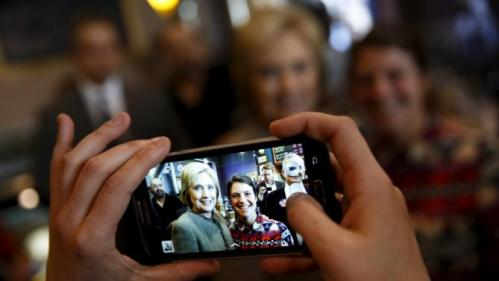U.S. Democratic presidential candidate Hillary Clinton poses for a picture while meeting people at Mapps Coffee in Minneapolis, Minnesota March 1, 2016. REUTERS/Jonathan Ernst